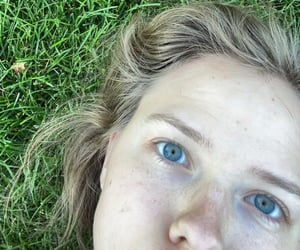 eyes, freckles, and grass image