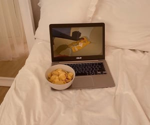 bed, chilling, and crisps image