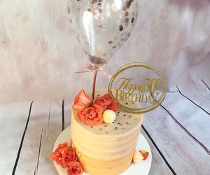 balloon, cake topper, and roses image