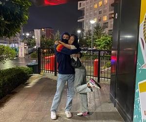 city, friendship, and hug image