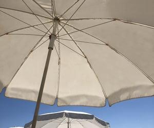 beach umbrella, sand, and turkey image