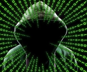 breach, cyber, and hacker image