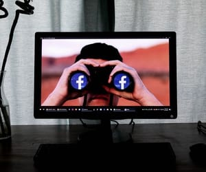 binoculars, facebook, and search image