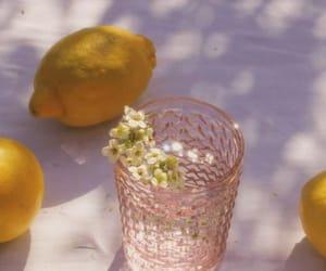 flowers, glass, and lemon image