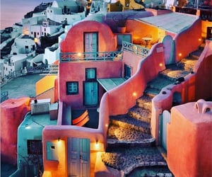 Colorful homes Clinging to a Cliff - Santorini, Greece.