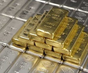 gold bullion, silver bullion, and antique coins image