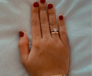 cartier, red nails, and wedding ring image