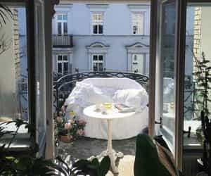 luxury lifestyle, Sunny, and sitting on a balcony image