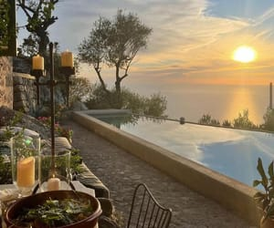 candles, food, and infinity pool image