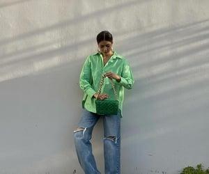 baggy jeans, hoop earrings, and pose image