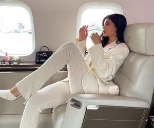 luxury lifestyle, private plane, and cream suit image