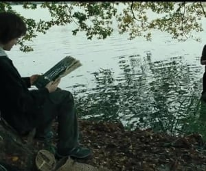 Reading by the black lake.