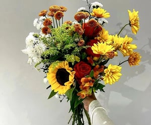 Happiness is the art of making a bouquet of flowers.