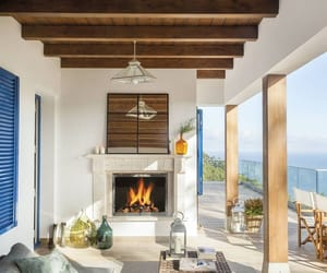 chilling, fireplace, and furniture image