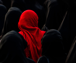 red, black, and muslim image