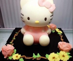 hello kitty and stuffed image