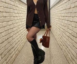 black boots, brown bag, and brown cardigan image