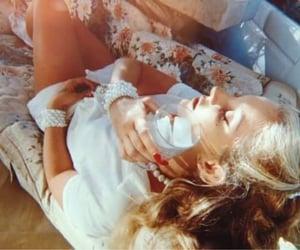 blonde, pearls, and red nail polish image