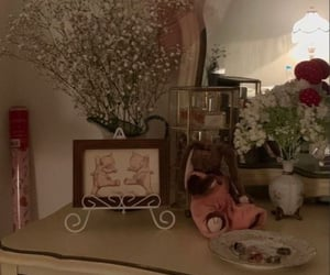 dresser, flowers, and mirror image