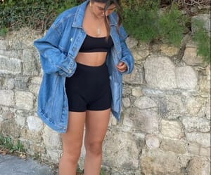 denim jacket and biker shorts image