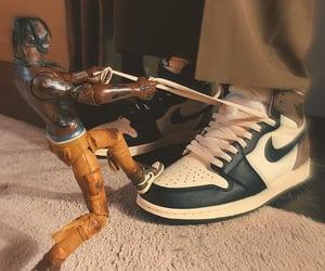 action figure, jordans, and brown image
