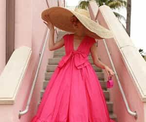 luxury lifestyle, large hat, and pink dress image