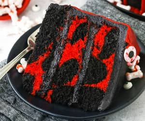 red and black marble halloween cake with black chocolate buttercream