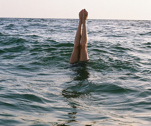 sea, legs, and water image