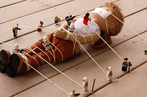 brick, doll, and gulliver's travels image