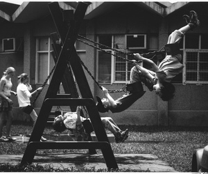 child and swing image