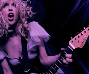 Courtney Love, guitar, and hole image
