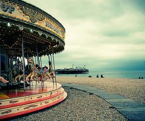 carousel, beach, and sea image