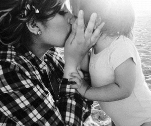 baby girl, black and white, and kiss image
