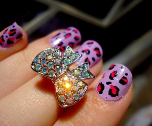 nails, bow, and ring image