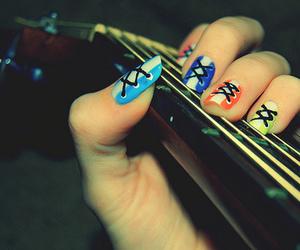 nails and guitar image