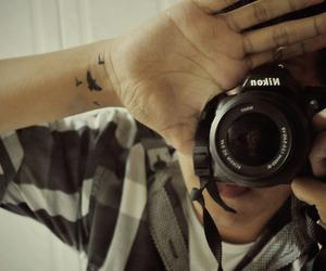 bird, boy, and camera image
