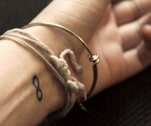 tattoo, infinity, and bracelet image
