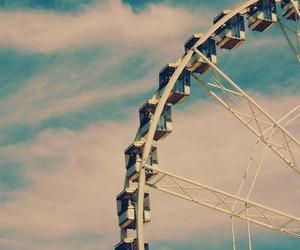 ferris wheel, fun fair, and sky image