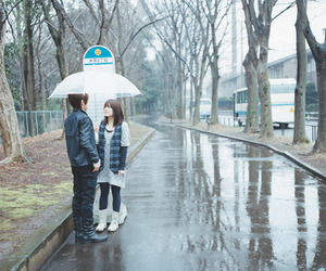 couple, love, and rain image