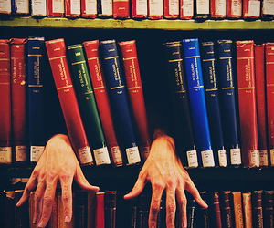 books and hands image