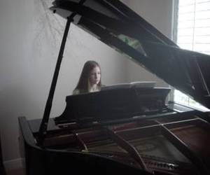 girl and piano image