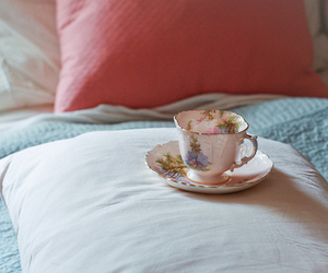 bed, cup, and pillow image