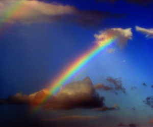 rainbow, blue sky, and clouds image