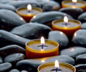 black and yellow, candles, and rocks image