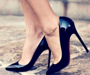 christian louboutin and heels image