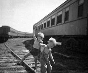 black and white, boys, and train image