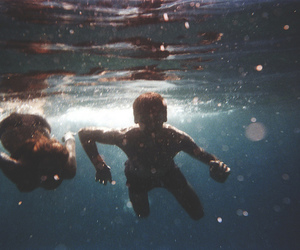 water, boy, and girl image