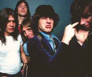 bon scott, ac dc, and angus young image