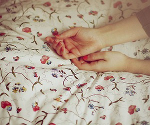hands, bed, and flowers image