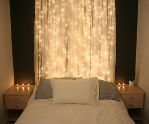 bed and bedroom. lights image